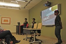 Student Wellness Advocay Team (SWAT) members spoke to  interested students about the organization. Photo by Kathryn Funderburk