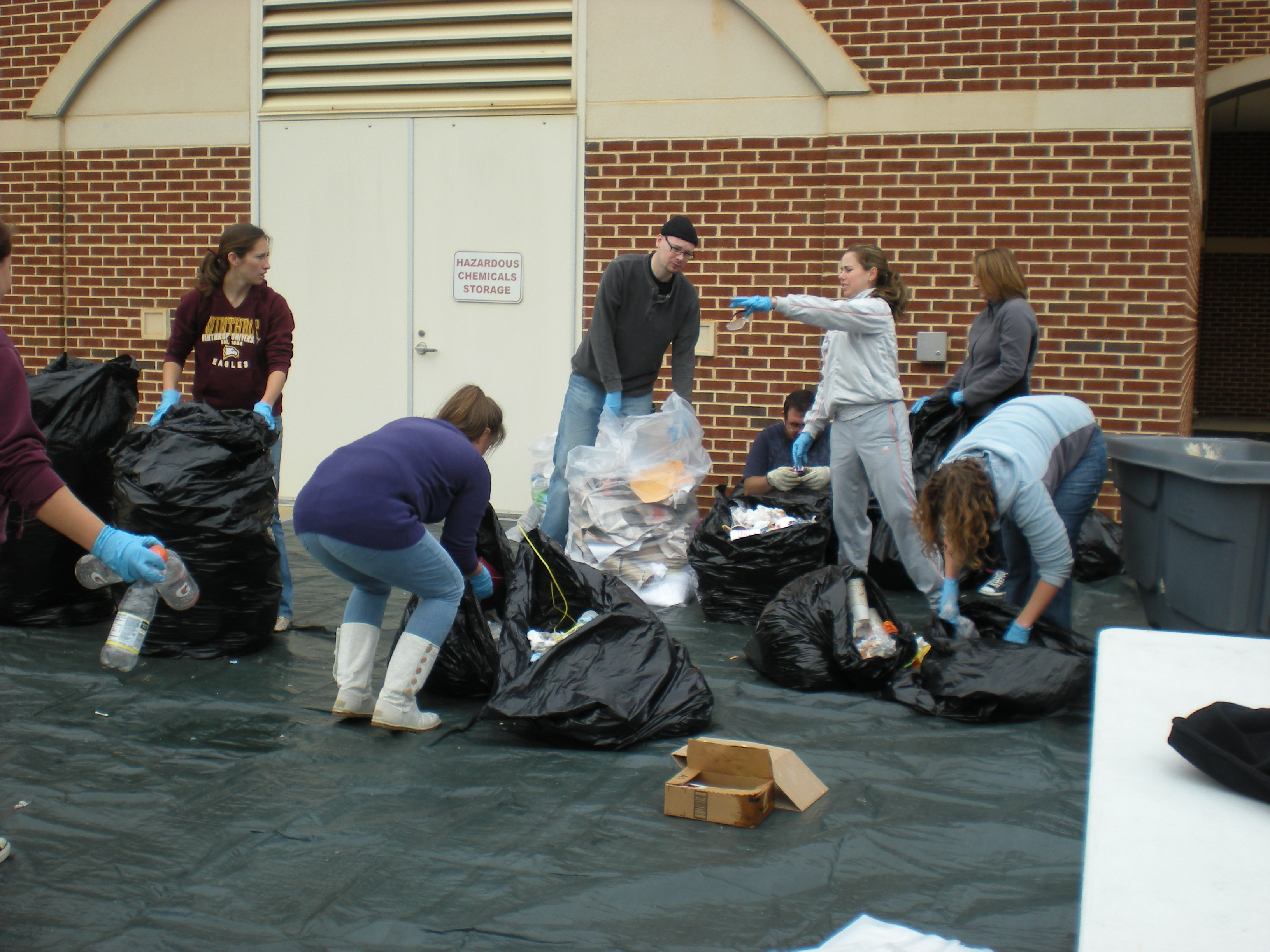 ECO members sort through trash at the Waste Audit. Photo by Frances Parrish • parrishf@mytjnow.com