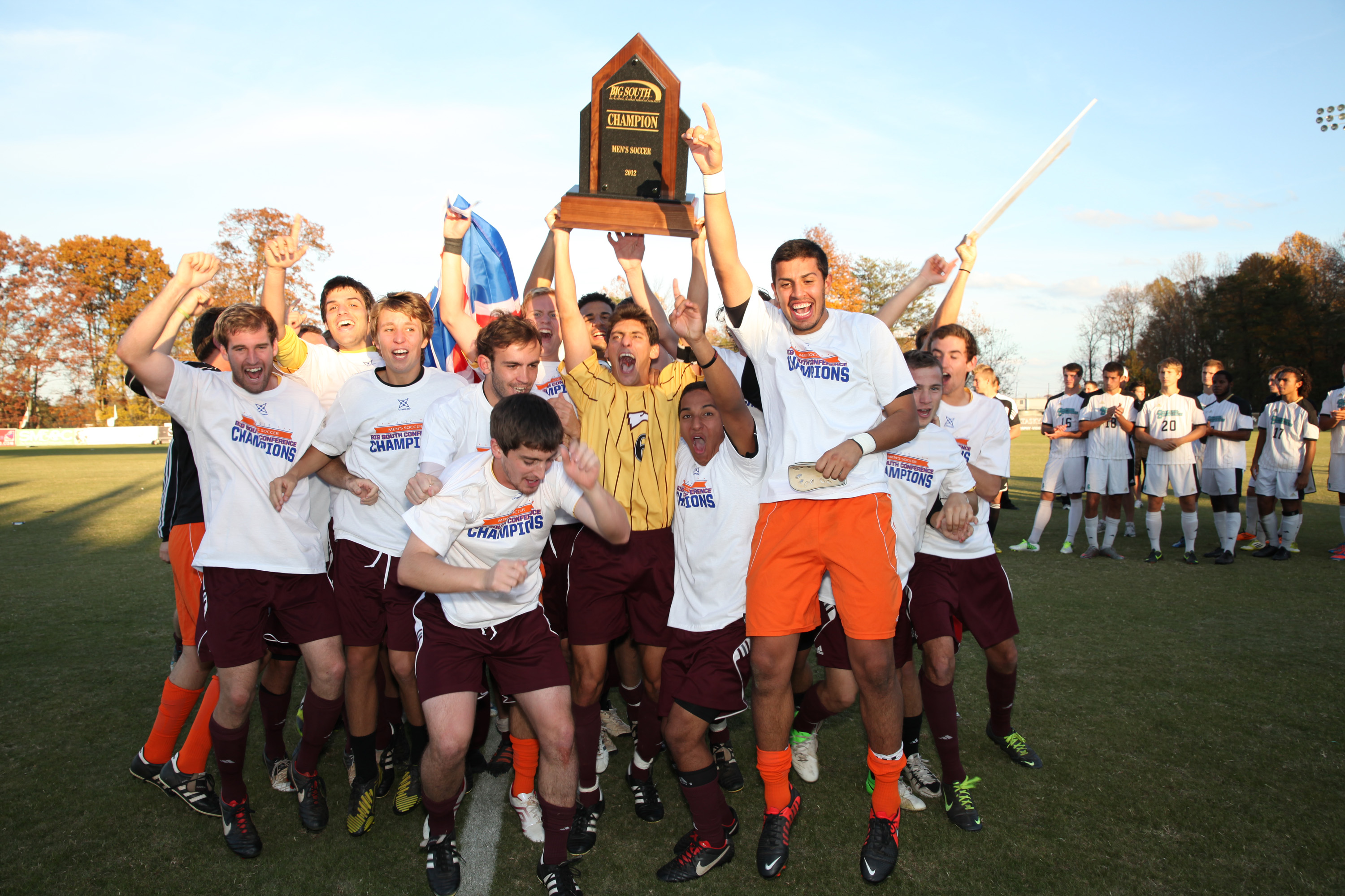 A jubilant Winthrop men's soccer team celebrates their Big South Championship victory as Coastal's players look on. Photo courtesy of bigsouthsports.com.