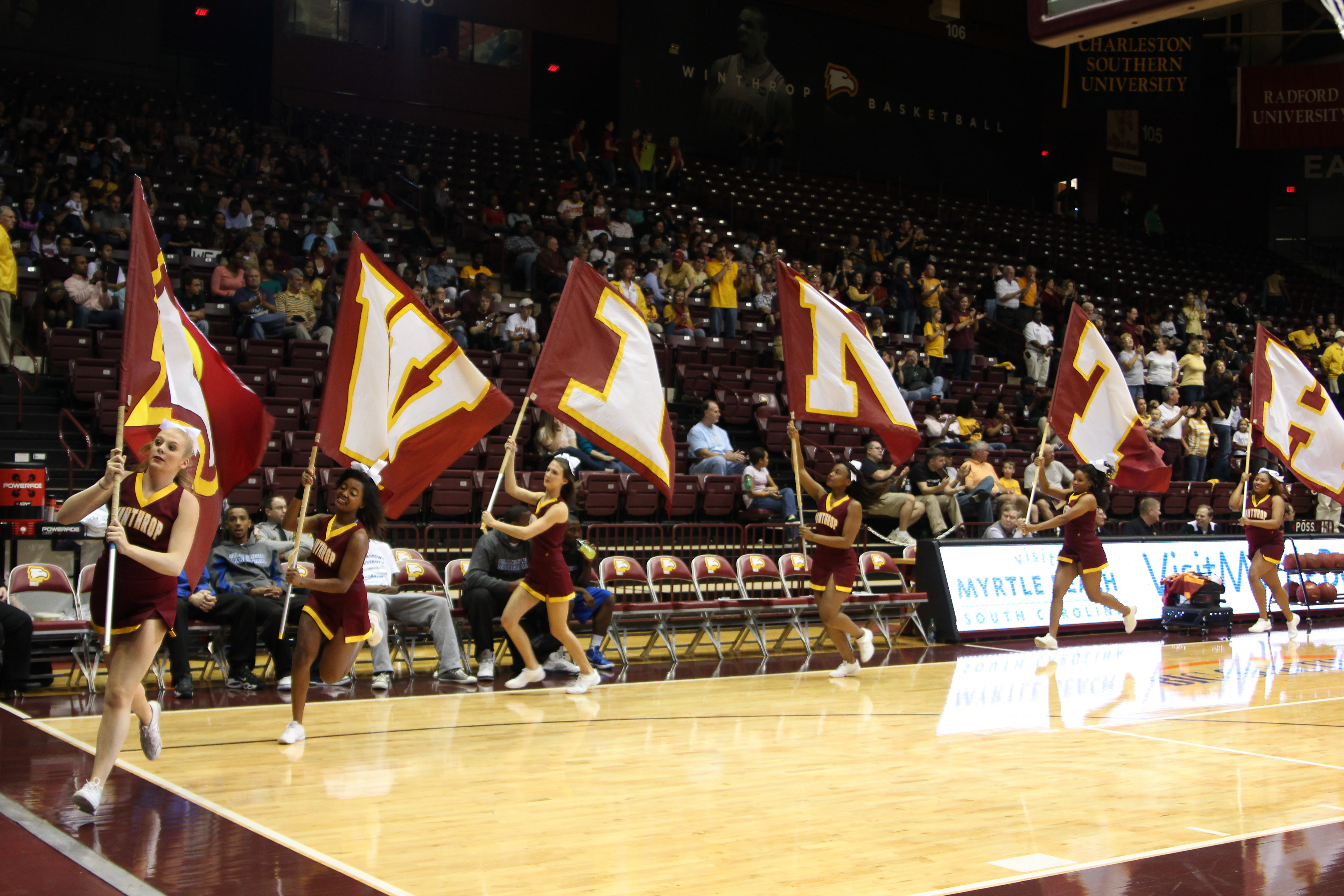Winthrop cheerleaders rally the crowd at Homecoming. Photo by Jacob Hallex • hallexj@mytjnow.com