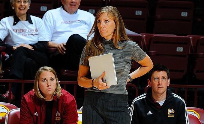 Volleyball Coach Julie Torbett stands on the sidelines of a home court game. Photo courtesy of Winthrop Athletics