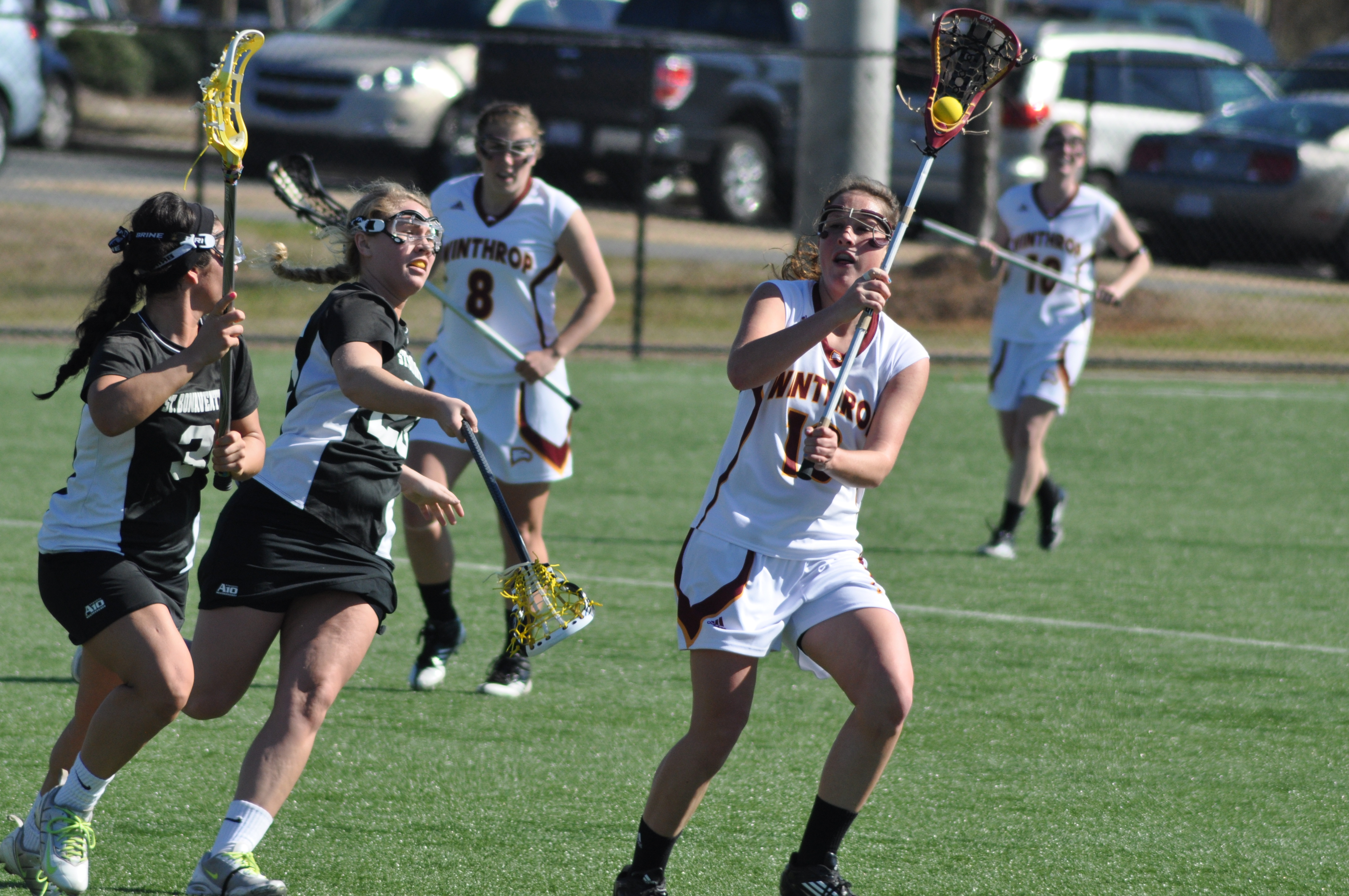 Marguerite Montanye and Logan McCarthy in action on the lacrosse field.  Photo by Synera Shelton • sheltons@mytjnow.com