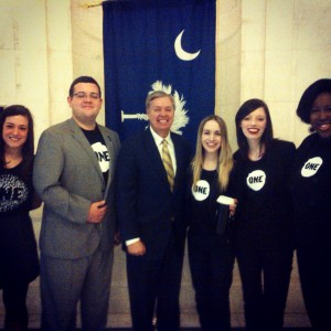 Kyle Grassi, Phillip Reyonlds, Brandi Geurkink, Latwyla Mathias and Sarah Cohen stand with Sen. Lindsey Graham (R) in the capital