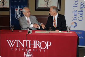 Photo courtesy of Winthrop University - DiGiorgio (left) and Rutherford signed the Bridge Program into existence Thursday morning on the third floor of the DiGiorgio Campus Center