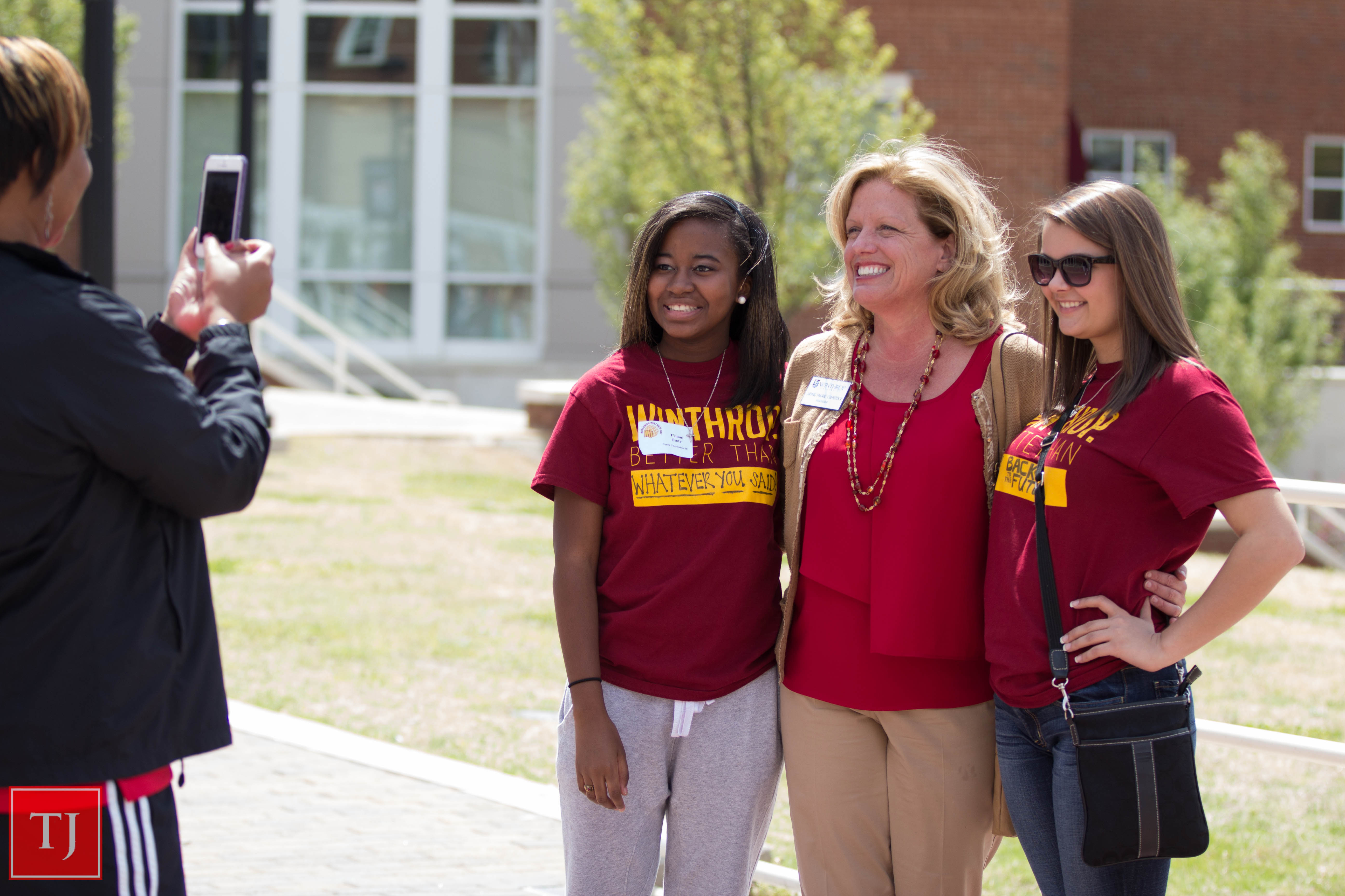 Williamson posing for a photo with future students at World Wide Winthrop Day 2014. Photo by Jacob Hallex
