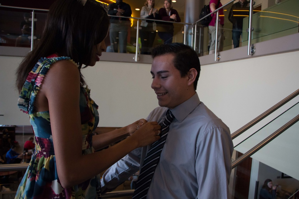 Roberto Avalos receiving his Homecoming Court pin. Photo by Jacob Hallex.